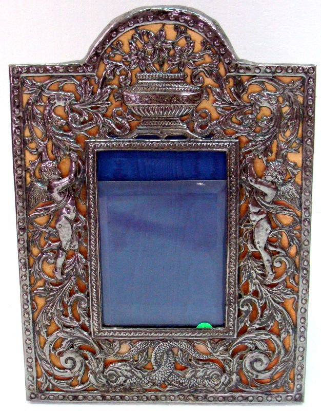 607: Antique Silver Plated Figural Picture Frame