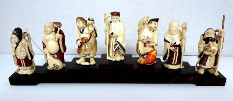 7 Chinese Polychrome Carved Ivory Immortals on Stand