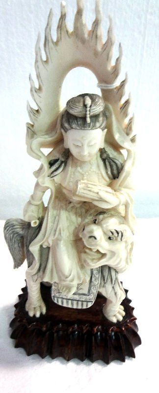 Antique Chinese Carved Ivory Figurine on Foo Lion