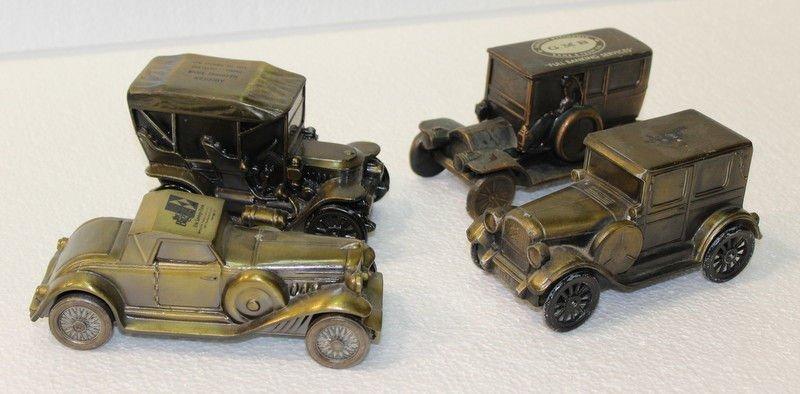 Set of 4 Antique Metal Toy Car Coin Banks