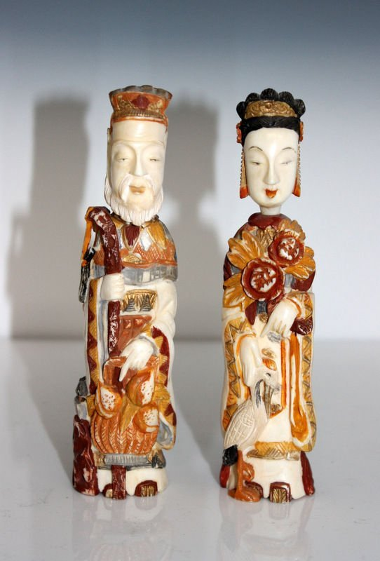 Pair of Chinese Carved Polychromed Ivory Snuff Bottles