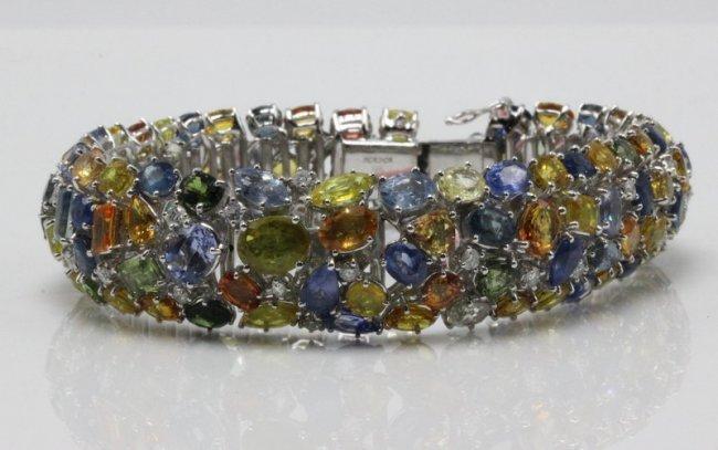 18Kt WG 67.31ct. Colored Sapphire & 1.46ct. Diamond