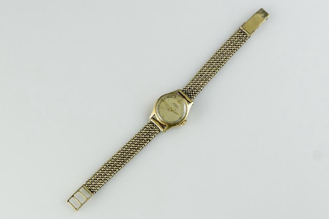 Gold Doxa Watch