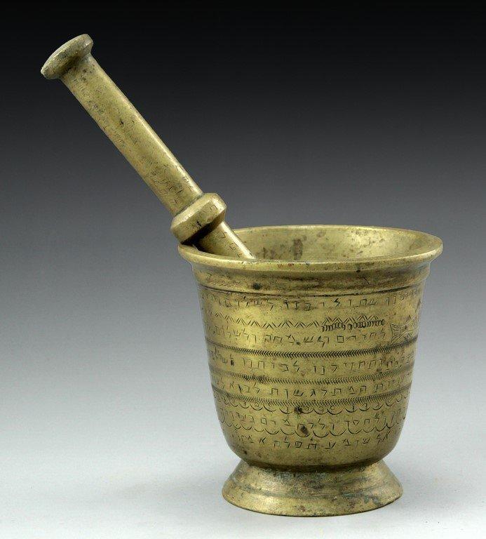 Mortar and pestle with kabbalic writings
