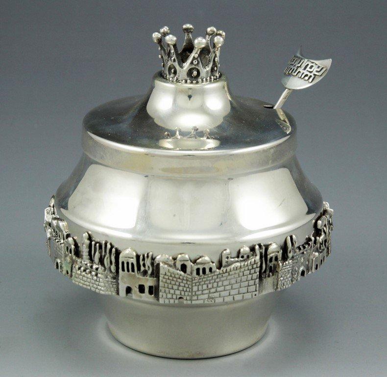 A silver honey holder by Bier