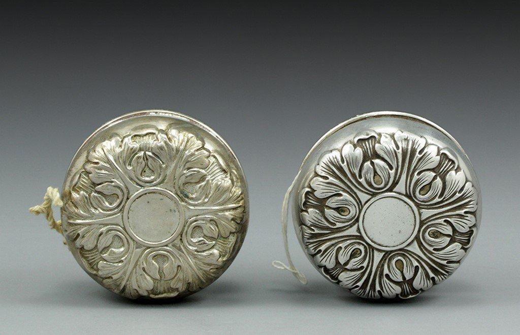 Lot of two silver Yo-yos