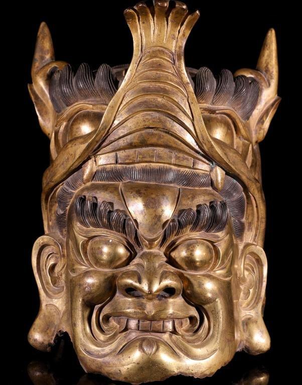 A Chinese Gilt Bronze Buddha Head
