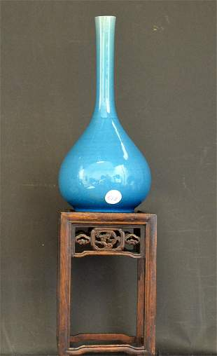 A Chinese Porcelain Turquoise Vase on Wood Stand