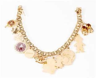 Yellow Gold 14K Charm Bracelet with Eleven Charms