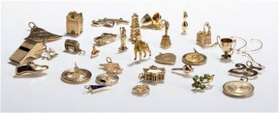 Twenty Seven Yellow Gold Charms and Pin.
