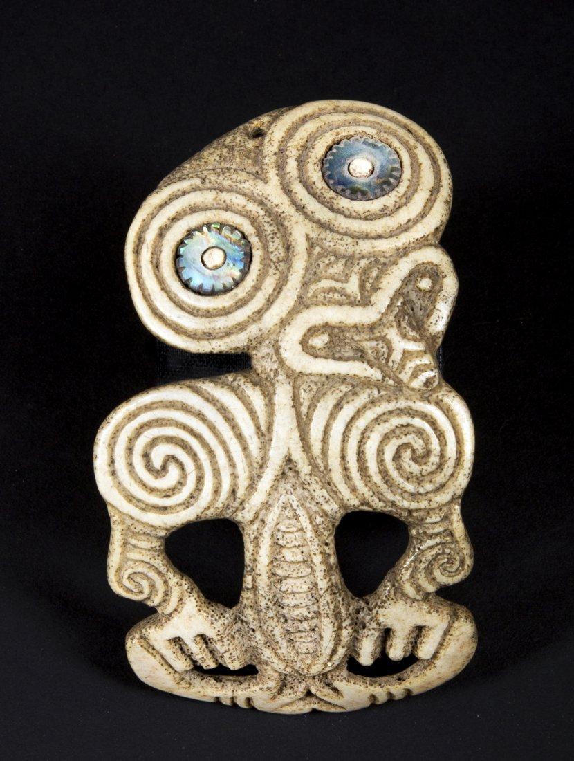 A very fine and rare Human bone Tiki