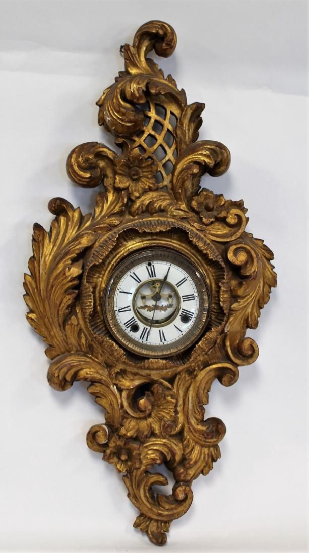 Ornately Carved and Gilt Wood Clock