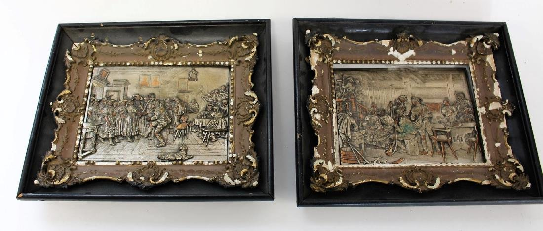 Pair of Continental Silvered Copper Relief Plaques