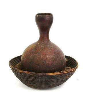 African Memorial Pottery Vase in Basket