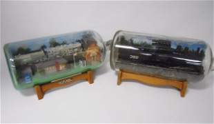 Two Model Train Displays in Glass Bottles