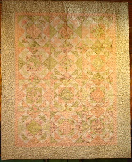"""13: """"SOFT TOUCHES"""" lap quilt in soft peach, celery and"""