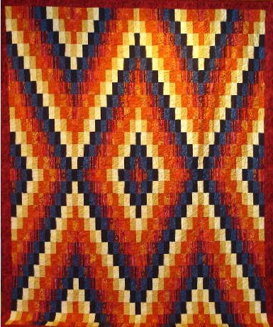 """18: """"NAVAJO DAWN"""" full size quilt in orange, gold and b"""