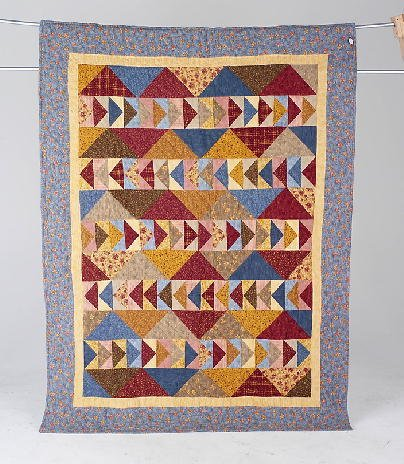 5: PEAKS & GEESE flannel lap quilt with an abundance of