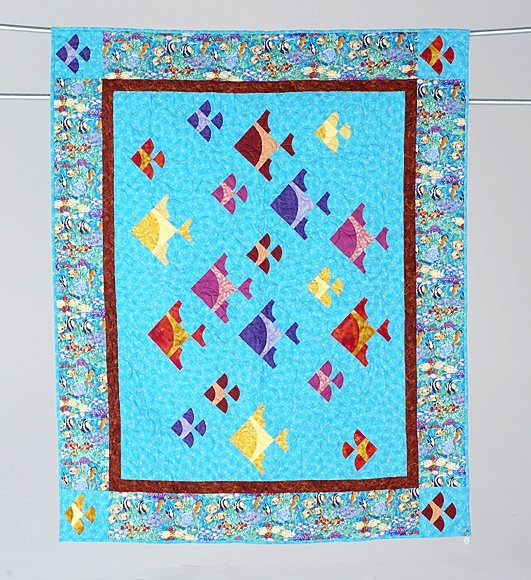 6: DIFFERENT DRUMMER lap quilt by Judith Keck. This qui