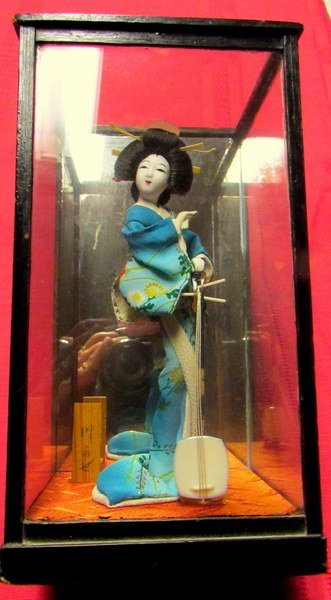 Japanese Geisha Doll  in Sealed Clear Chamber.