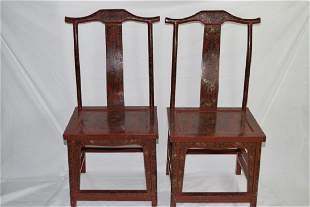 Pair of Chinese Carved Red Lacquer Filled Chairs
