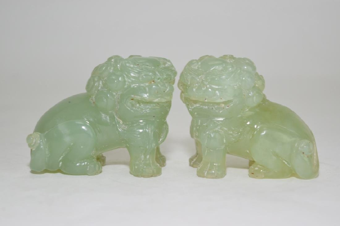 Pair of Chinese Light Green Jade Carved Lions
