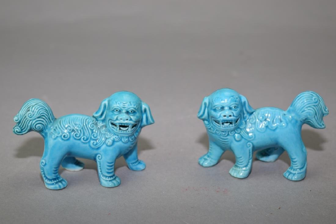 Pair of Chinese Peacock Blue Glaze Lions