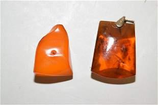Two Chinese Amber/Butterscotch Amber Pendants