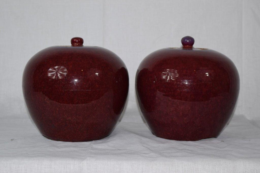 Pair of Chinese Red Flambé Covered Jars