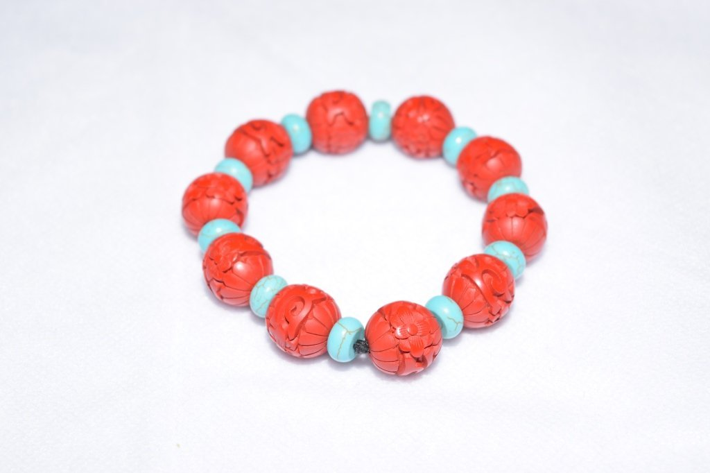 Turquoise and Cinnabar Carved Bead Bracelet