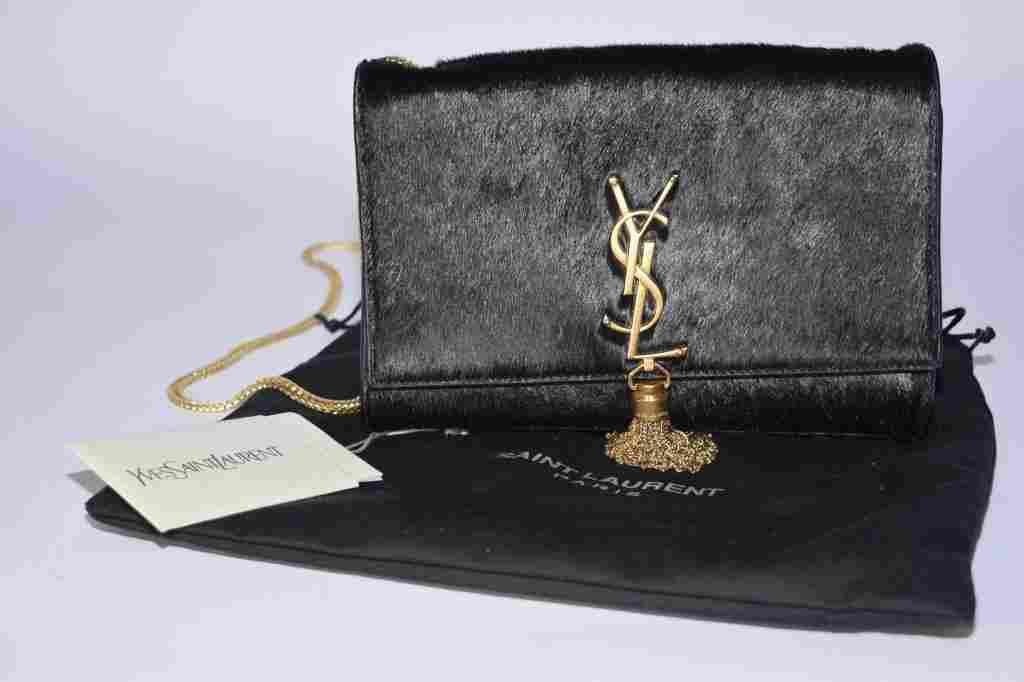 Authentic Yves Saint Laurent Monogram Tassle Sachel