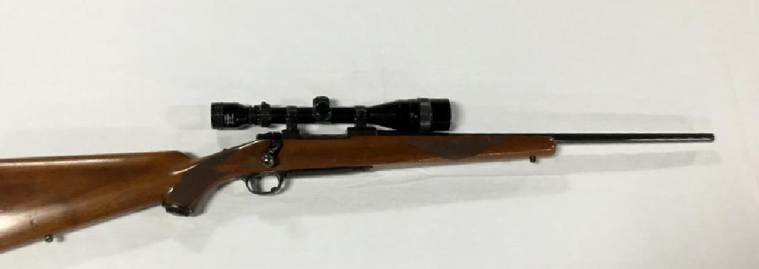 Buyer M-77  243  Bolt Action