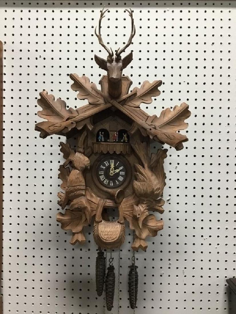 Hand Carved German Hunters Style Walnut Cuckoo Clock