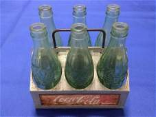 Coca-Cola Bottle carrier and 6 Rare bottles