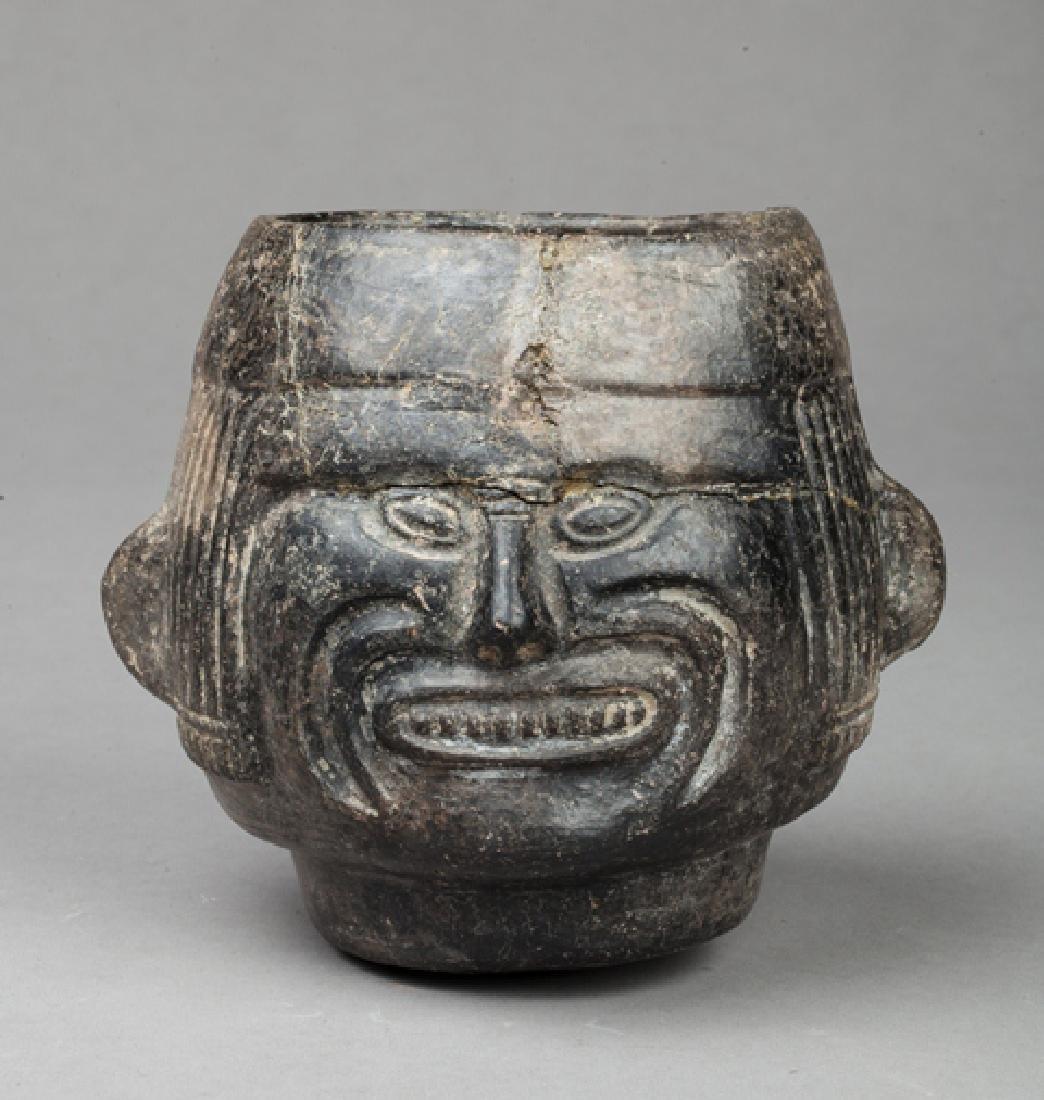 Shaman head vase