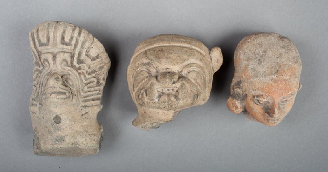 Three Tumaco heads