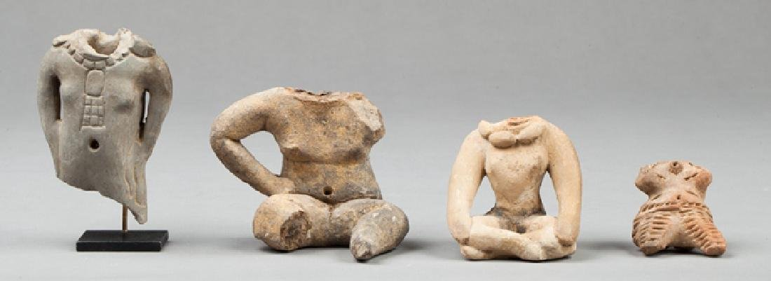 Three fragments and a statue