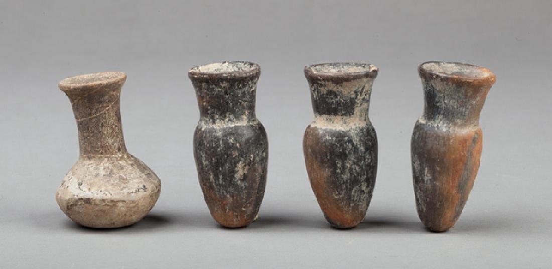 Four aztec potion flasks