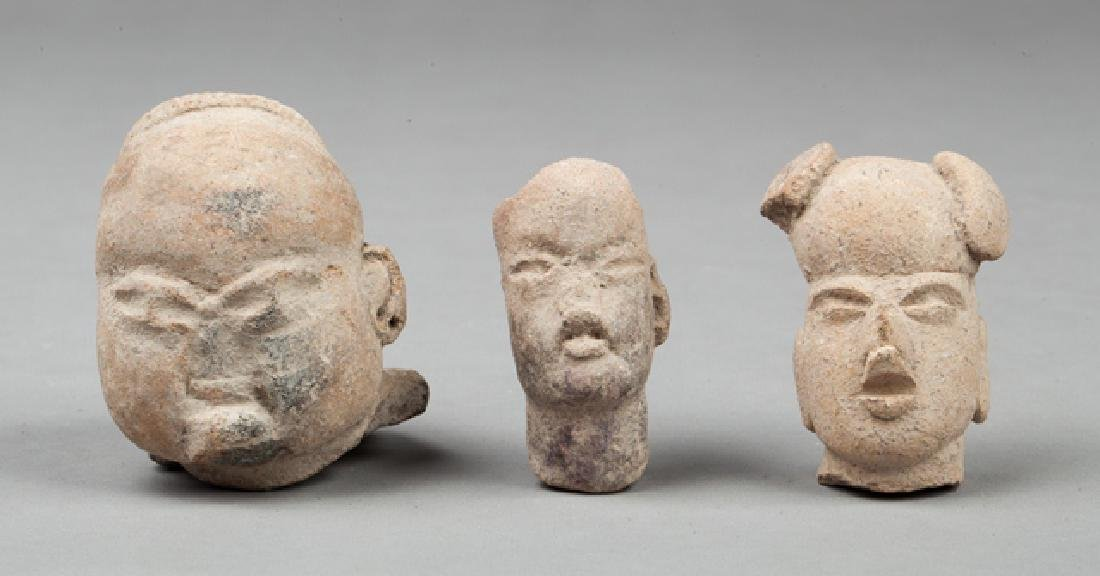 Three olmec heads