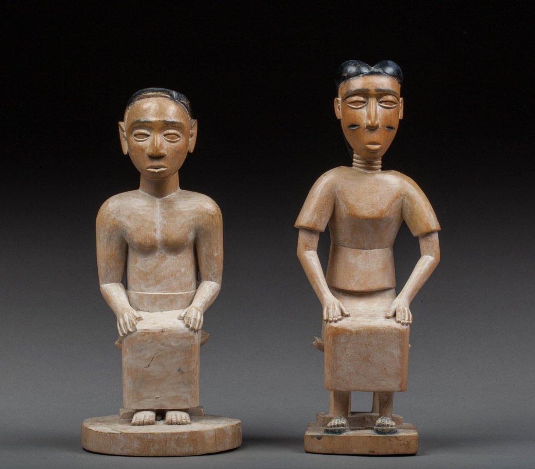 Ewe pair of statues