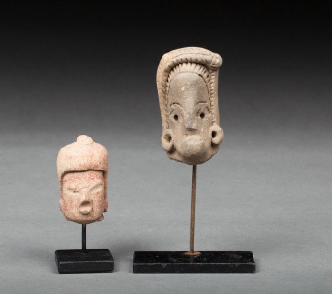 Two precolumbian heads