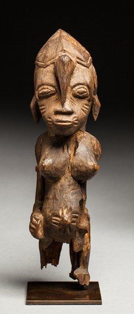 Standing feminine statue