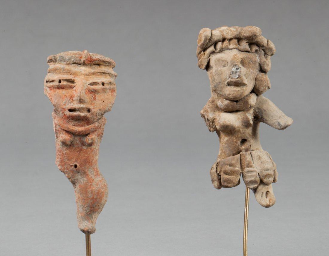 Two tlatilco feminine statues