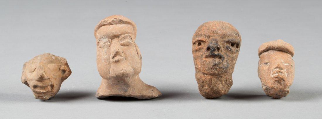 Olmec chest and three heads