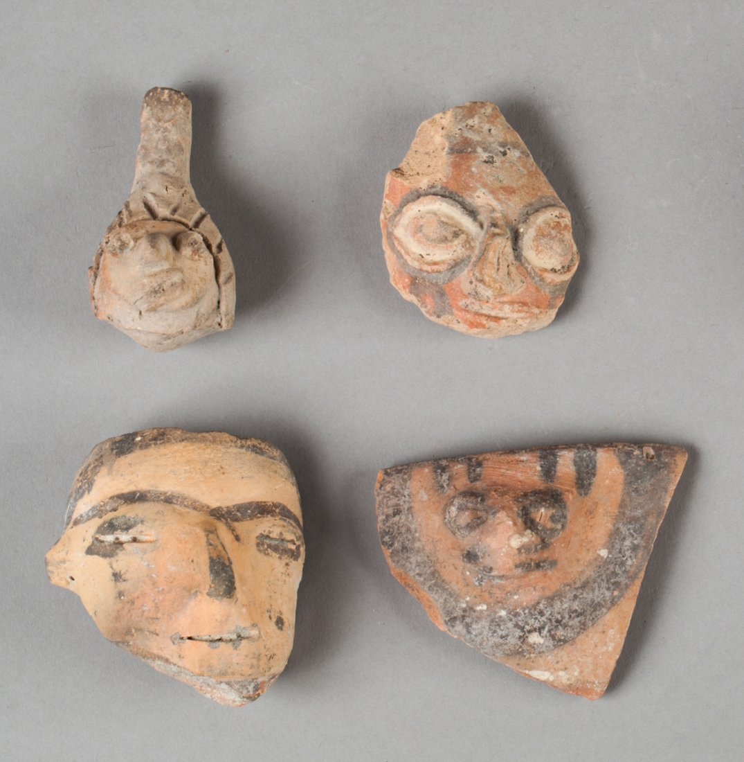 Three Huaxtec heads and a Colima Ocarina.