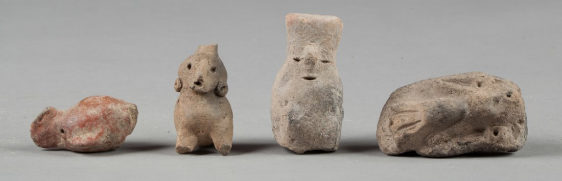 One mayan figure and three pieces