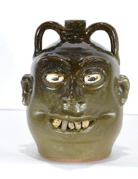 Lanier Meaders.  Dbl-Sided Rock Tooth Face Jug.