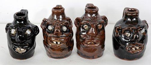 6: Marie Rogers Group of 4 Mini Face Jugs.