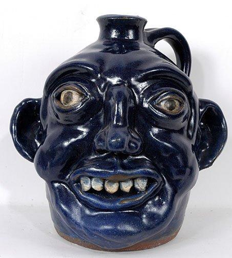 18: Kim Black Blue Face Jug