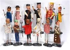 12 Antique Puppets.
